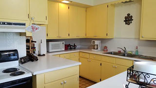 The yellow kitchen in the Steele mansion.