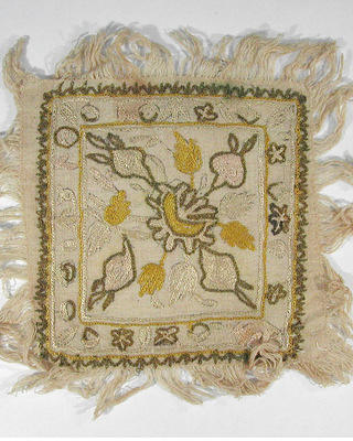 "Embroidery sample, early 19th century. Needlework sample measuring approximately 6"" square with 1"" fringe on each edge."