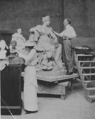 Black and white photo from 1915 showing Margaret French Cresson and Daniel Chester French in the Chesterwood studio, sculpting.
