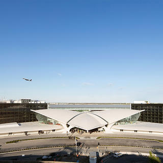 The exterior view of Eero Saarinen's TWA Flight Center and the two new hotel buildings behind it.