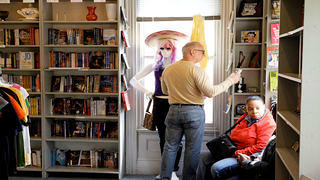 In the store, customers browse the bookshelves.