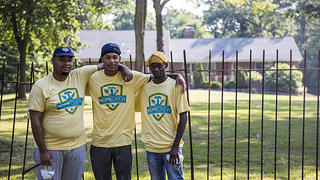 HOPE Crew participants restore the fence at the John and Alice Coltrane Home in Dix Hills