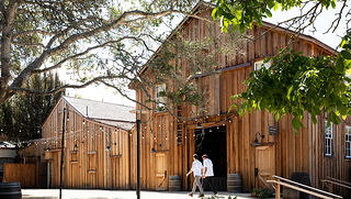 Barns at Cooper Molera with two people_AngelaDeCenzo
