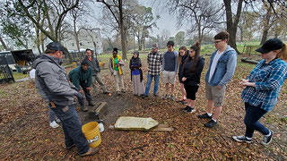 HOPE Crew participants learn about cemetery restoration at a workshop at Houston's Olivewood Cemetery.