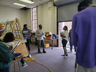 Tuskegee University students and faculty, along with community members, take part in a HOPE Crew window restoration workshop.