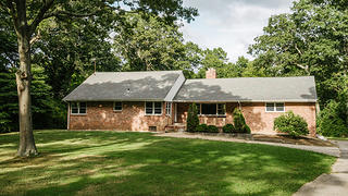 Built in 1952, this Midcentury Ranch house in Dix Hills, New York, in 1964 was once the home of John and Alice Coltrane.