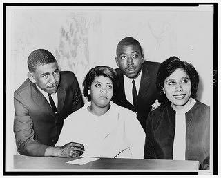 A 1964 image of Linda Brown Smith, Ethel Louise Belton Brown, Harry Briggs, Jr., and Spottswood Bolling, Jr.  all central to the Brown vs. Board of Education Case that ended legal segregation in schools in the United States. at a press conference at the Hotel Americana.