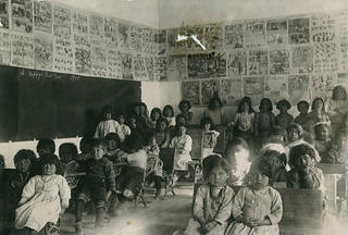 Students in classroom at Santa Fe Indian School, 1900.