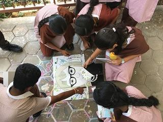 Students piece together the Janu(e) Jigsaw puzzle as part of the story telling discussion activity from the Observe program. Vellore 2018.