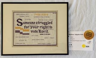 A piece by Marlena Salgado-Felix from the 2020 Woodlawn Needlework show about the 19th Amendment.
