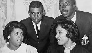 Linda Brown Smith, Ethel Louise Belton Brown, Harry Briggs, Jr., and Spottswood Bolling, Jr. during press conference at Hotel Americana.