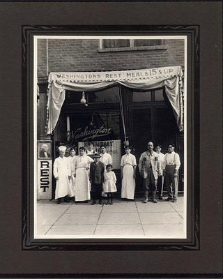 The Harada family in front of Washington Restaurant, which they operated.