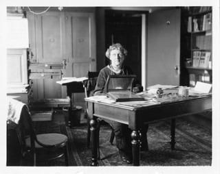 First hired by Harvard College Observatory to carry out astronomical calculations, Annie Jump Cannon (1863-1941) eventually became one of the foremost American astronomers, known especially for her work on variable stars. This photograph shows her at her desk at the observatory.