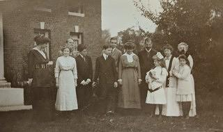 Helen Gould, second from the right (in white sweater with dark trim) stands with her two nieces (on either side of her), friends, and family outside the newly constructed pool building, photo c. 1911.