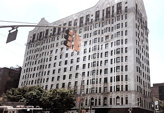 Image of a large building that was once a hotel listed in the Green Book. Today it operates as an office building.