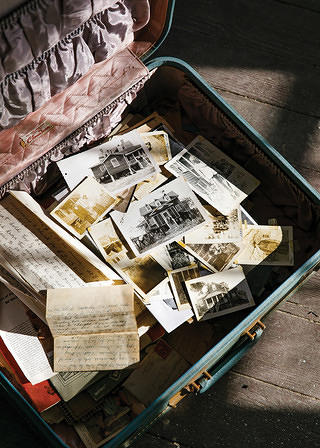 A suitcase filled with Hutchinson family mementos.