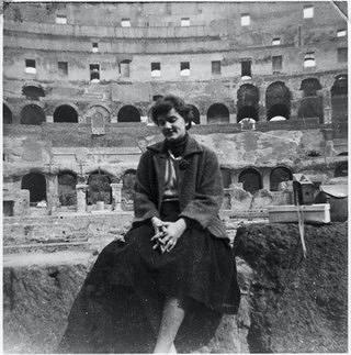 A woman, Suzan Shown Harjo, sitting on the interior of the Colosseum in Rome.