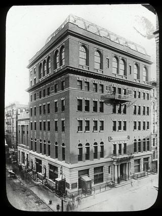 Exterior view of a building in New York City that was one of the first settlement houses in the United States.