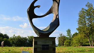 A circular sculpture on an expanse of land by Dorothy Riester