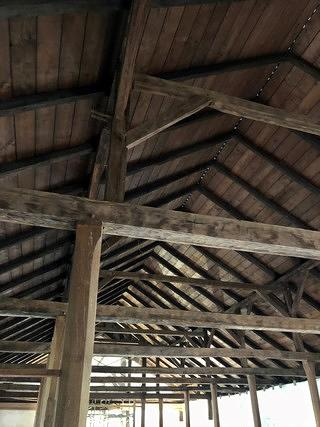 Interior of Mokuaikaua Church with wooden beams overhead creating the framing.