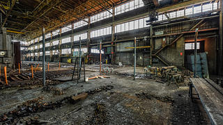 Interior of a former factory after initial demolition has occurred.