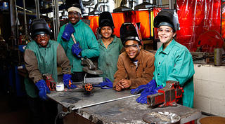 A group of students taking part in welding training at Northland Workforce Training Center