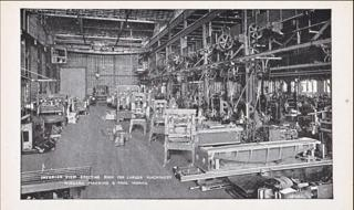 Black and white image from 1921 of the interior of a factory building in Buffalo. In this image you can see machinery.