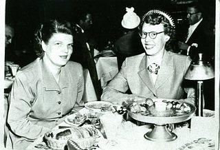 Image of two women sitting at at table.