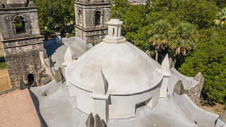 Aerial view of the dome at Mission Concepción, an old Spanish style mission in San Antonio, Texas.