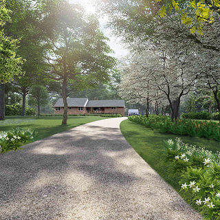 The site entry and approach showcases the restored Coltrane Home, softening the site entry and surroundings by improving the woodland setting and health of the front yard. Courtesy Nelson Byrd Woltz Landscape Architects.