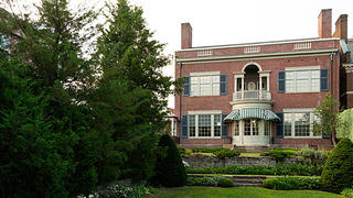 The rear of the Woodrow Wilson House with gardens and back lawn.